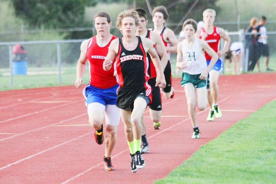 RUNNER: Reed City's Chad Zagacki leads the way in the boys 800 meters Monday while Chippewa Hills' Charles Piatt trails closely. (Herald Review photo/Greg Buckner)