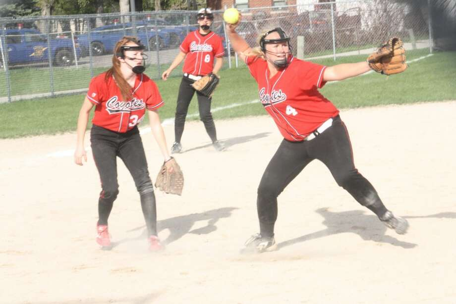 GREAT EFFORT: Reed City pitcher Jules Griffin (4) gets set to throw to first base while Lindsey Greer (34) stands by for support. (Herald Review photo/John Raffel)