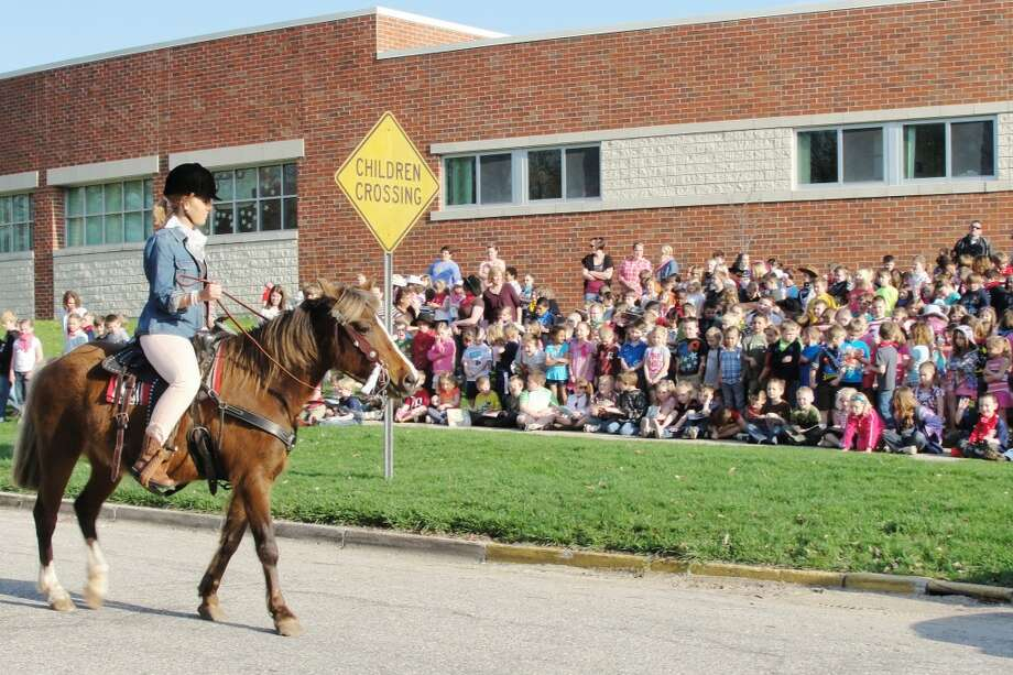 PART OF THE DEAL: Tonya Harrison upholds her promise to the students of GT Norman Elementary, and rides her horse through the streets around their school. (Herald Review photo/Shannon Hartley)