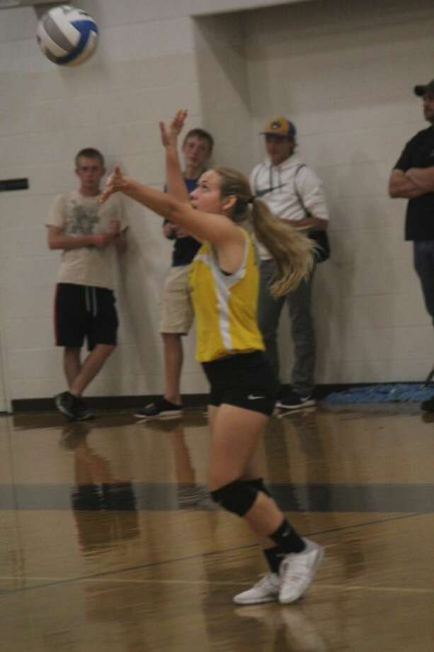 Kaylee Ladd plays the ball for Evart.