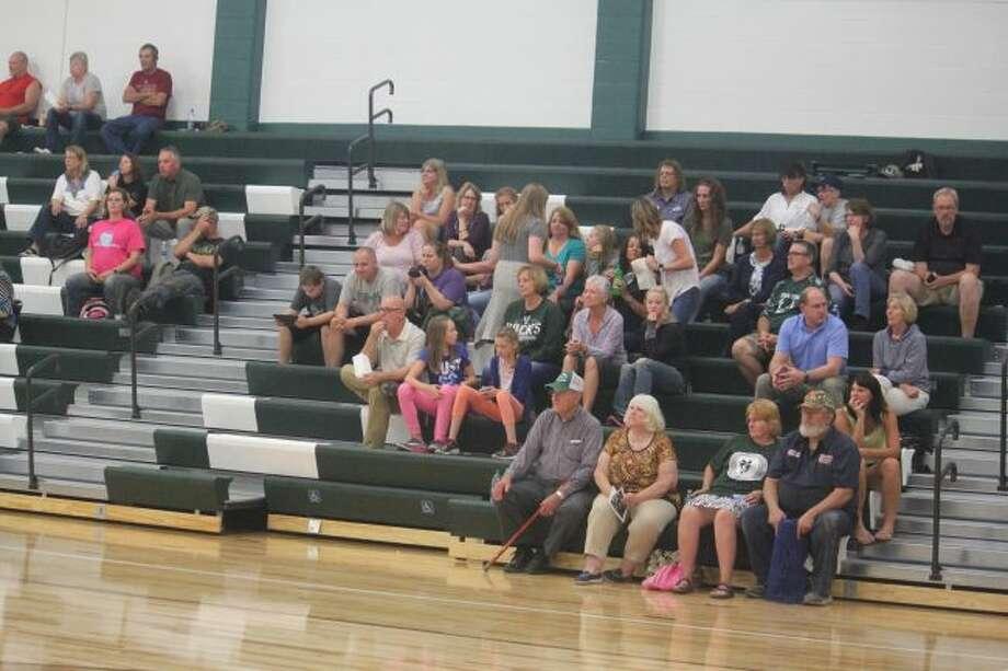 Pine River fans watch a volleyball match.