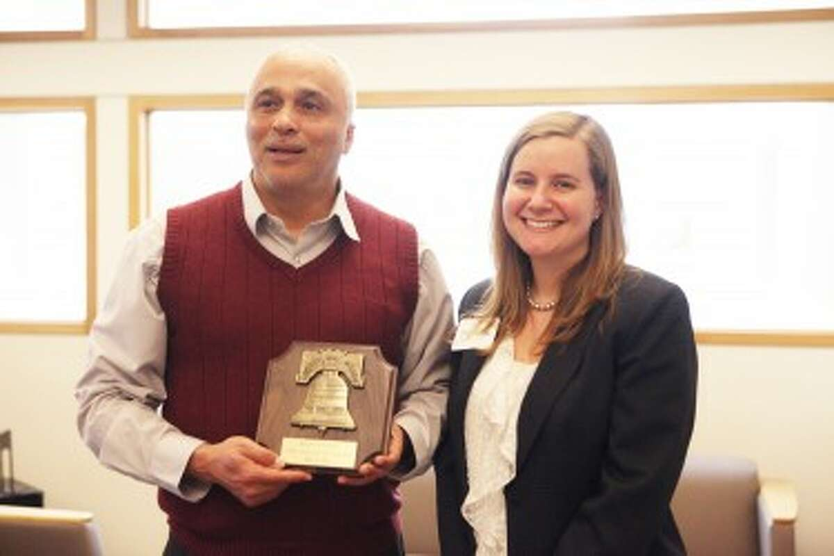 LIBERTY BELL: Emily Fransted, (BELOW) from the law firm Lobert and Fransted, presents this year's Mecosta County Liberty Bell Award to Dr. David Pilgrim, vice president for Diversity and Inclusion at Ferris State University.