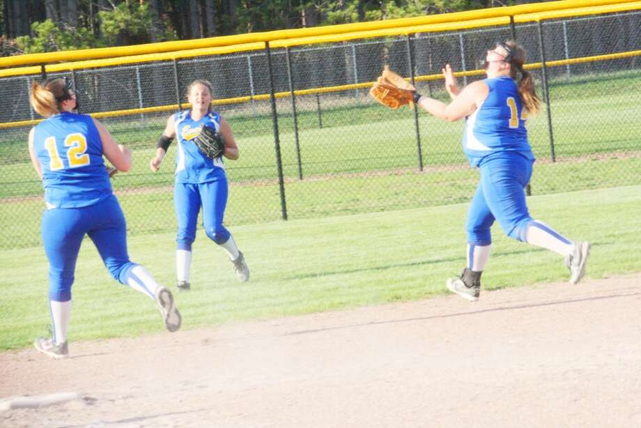 Two game split: Sabrina McKay (14) of Evart goes after a pop fly in softball action last week. (Herald Review/John Raffel)