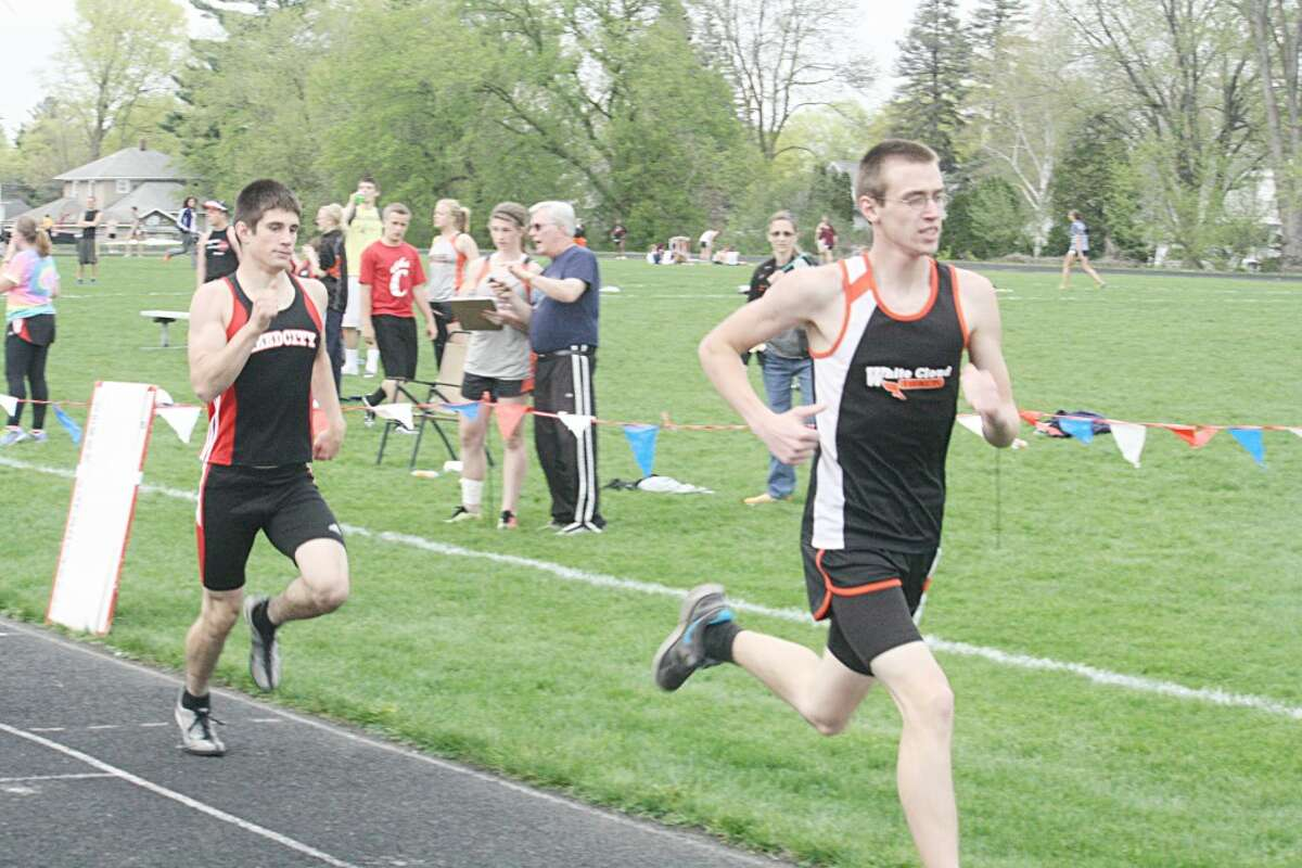 In the Race: Adam Kehr (left) finishes his race last week in the 800 (Herald Review photo/John Raffel)