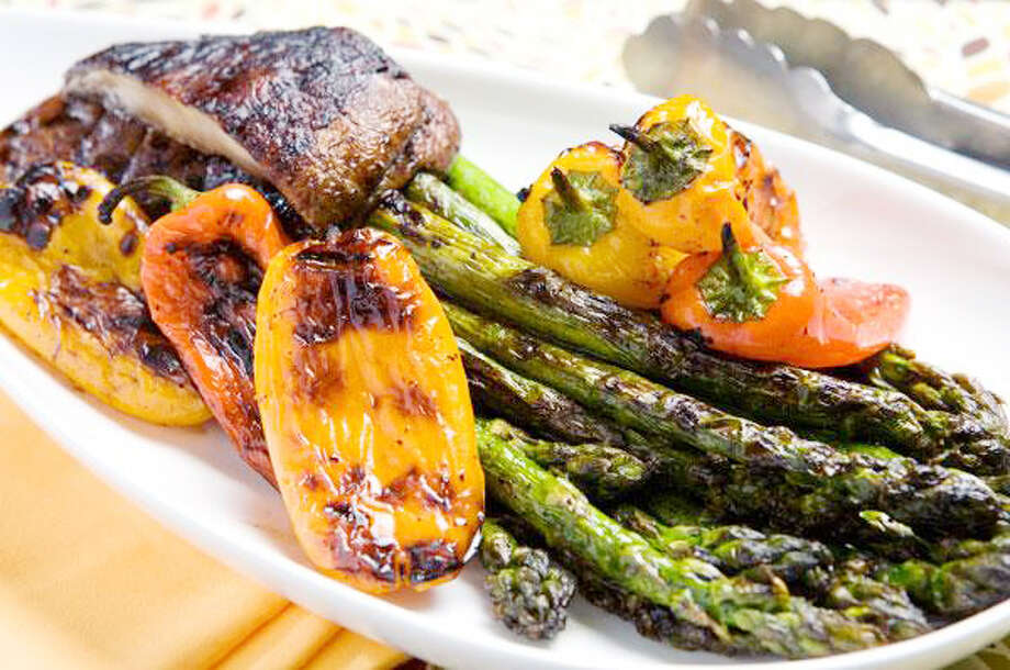 "Heathy grilling: Break up the normal routine of ftuits and vegetables by grilling them along with your burgers. Grilling offers a different set of flavors for familiar produce and some may even prefer the grilled texture to boiled or raw veggies. Many items even become ""meatier"" when grilled, as opposed to other types of cooking. (Courtesy image)"