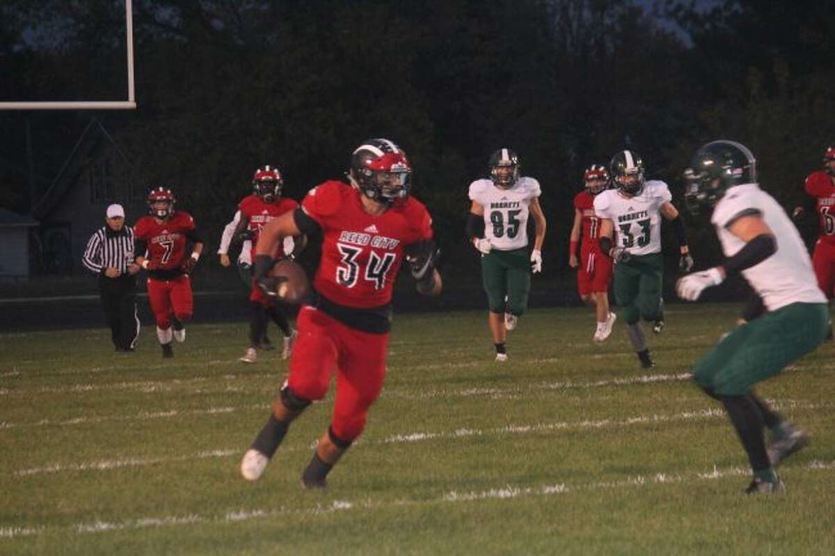 Anthony Pelton finds running room for Reed City.