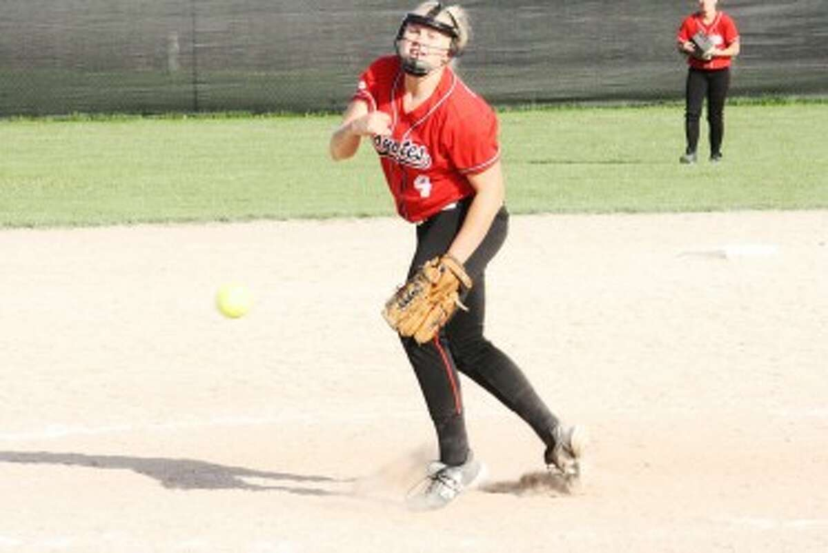 THROWING STRIKES: Reed City's Jules Griffin fires in a pitch toward home plate during Thursday's doubleheader against Big Rapids. (Pioneer photo/John Raffel)