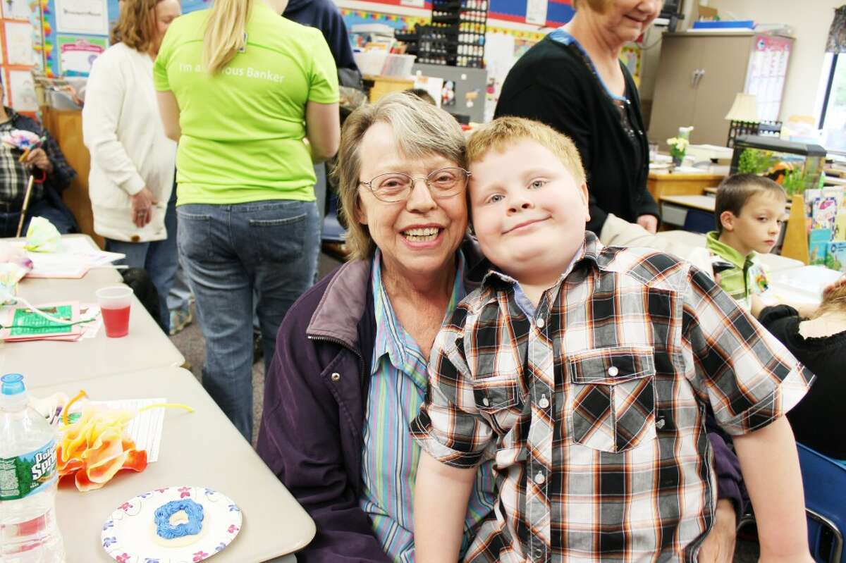 Concert for love: Rylee Saladin gets his grandma, Phylis Saladin, a snack after the concert. (Herald Review/Shannon Hartley)