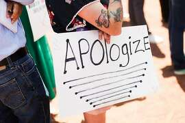 A protester opposed to President Donald Trump's visit to El Paso, Texas, holds a sign at a rally on Wednesday, Aug. 7, 2019. Trump is visiting El Paso and Dayton, Ohio, on Wednesday in an attempt to deliver a message of national unity and healing to two cities scarred by mass shootings over the weekend and where many grieving residents hold him responsible for inflaming the country's racial divisions. (Celia Talbot Tobin/The New York Times)