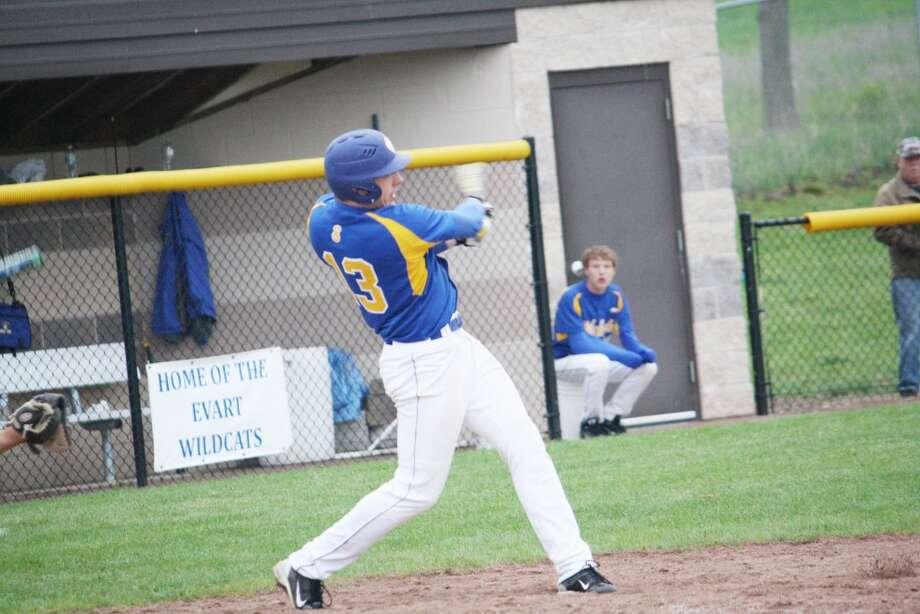 Baseball roundup: Devon VanOrder takes a swing at a pitch for Evart against Manton. (Herald Review/John Raffel)