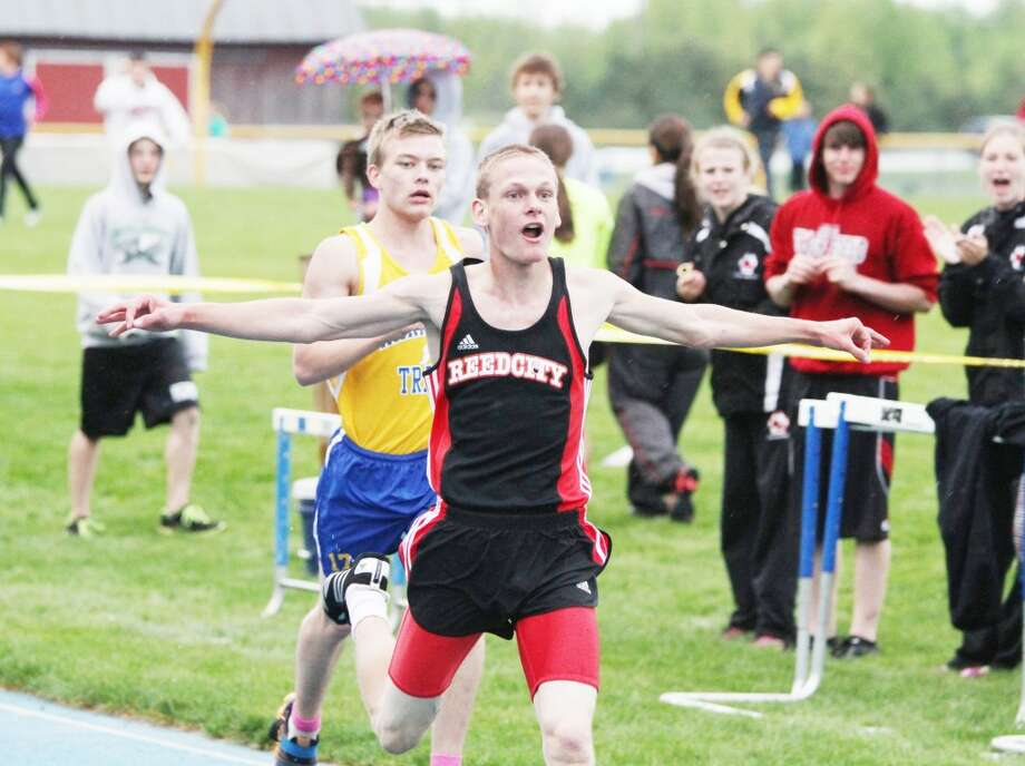 State finals: Reed City's Chad Zagacki reacts after winning the 3,200-meter run at the regionals. (Matt Wenzel/Herald Review photo)