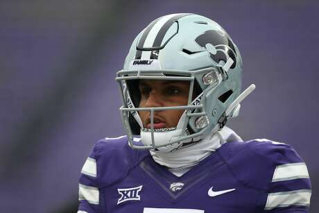 Alex Delton will stay in the Big 12 and still wear purple, but this time in TCU togs as he's the front-runner to take over as the Horned Frogs' starting quarterback.