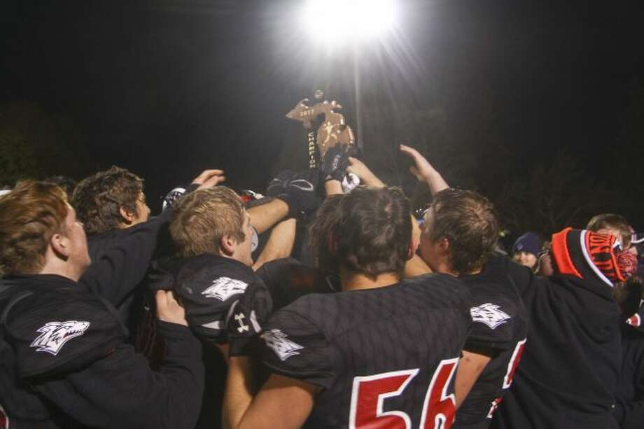 Reed City celebrates winning a district trophy