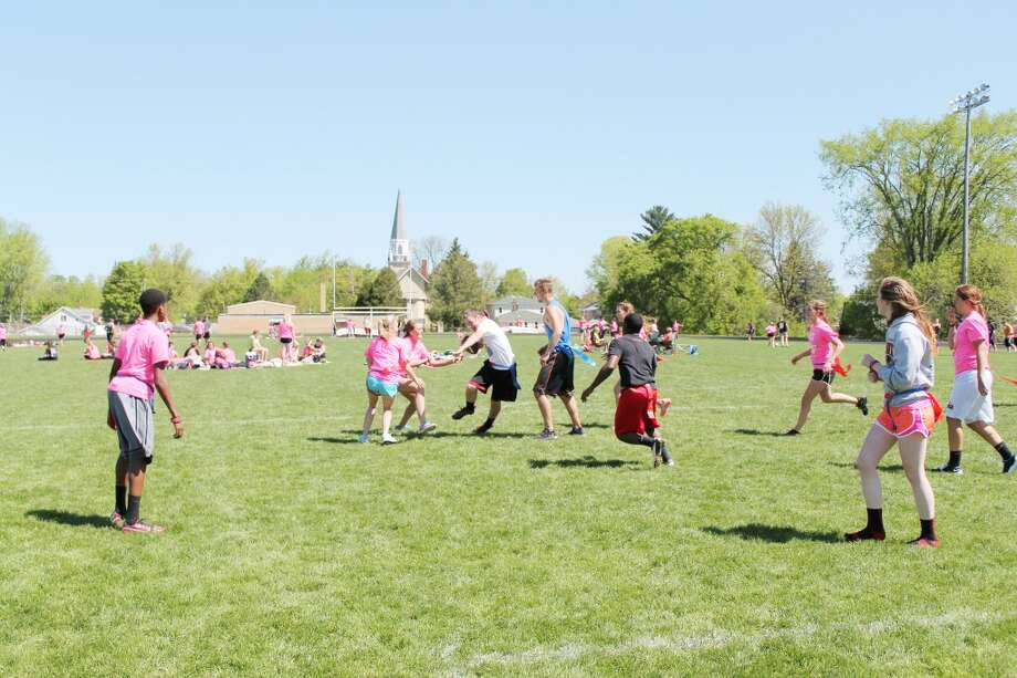 Playing for a cause: A friendly game of touch football was one of the activities during the Pass for Class event. (Herald Review/Shannon Hartley)