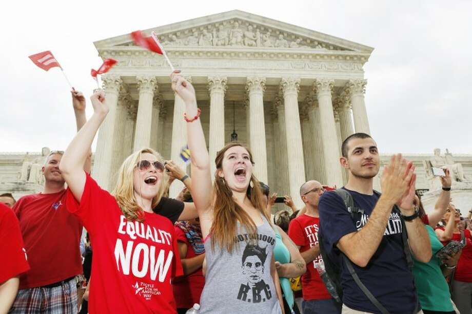 Supporters of gay marriage celebrate outside the Supreme Court on Friday, June 26, 2015 in Washington, D.C. The U.S. Supreme Court struck down bans on same-sex marriage in a historic 5-4 ruling. (Oliver Contreras/Zuma Press/TNS)