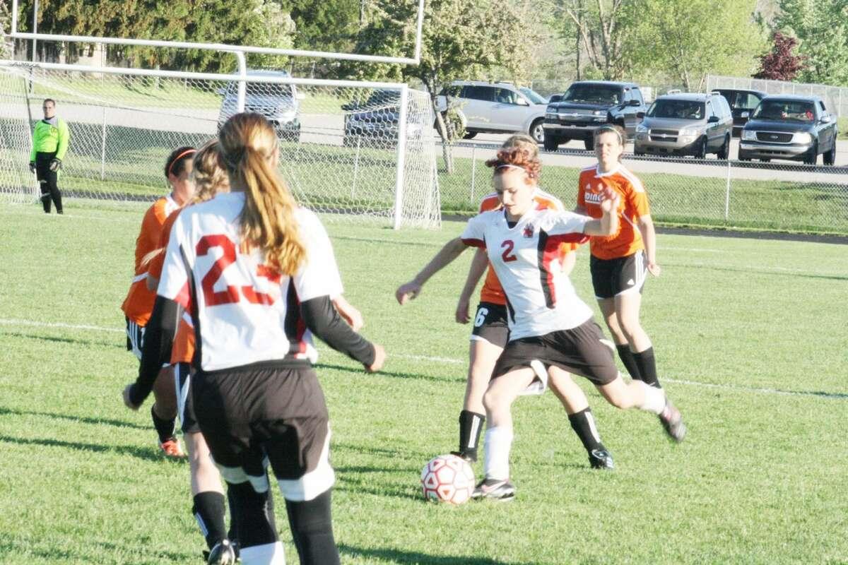 Soccer: RayAnne Shelden (2) works for the ball against Ludington last week. (Herald Review photo/John Raffel)