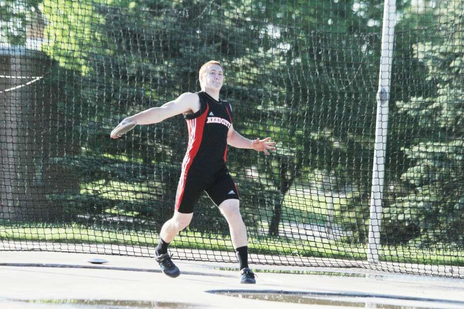 Throwing: Jon Green works on the discus during Friday's Pioneer meet (Herald Review photo/Greg Buckner)