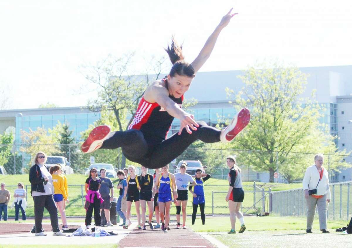 Four time winner: SamiMichell gives it her best shot at the Pioneer meet in the pole vault. (Herald Review/Martin Slagter)