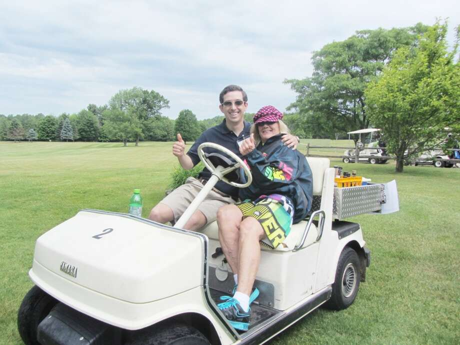 GOLF OUTING: Reed City Prosecuting Attorney Tyler Thompson and Carol Wojcok give a thumb's up during last year's Reed City Area Chamber of Commerce Golf Scramble while enjoying the event together. This year, the scramble will take place at 10 a.m. on June 7 at Spring Valley Golf Course. (Courtesy photo)