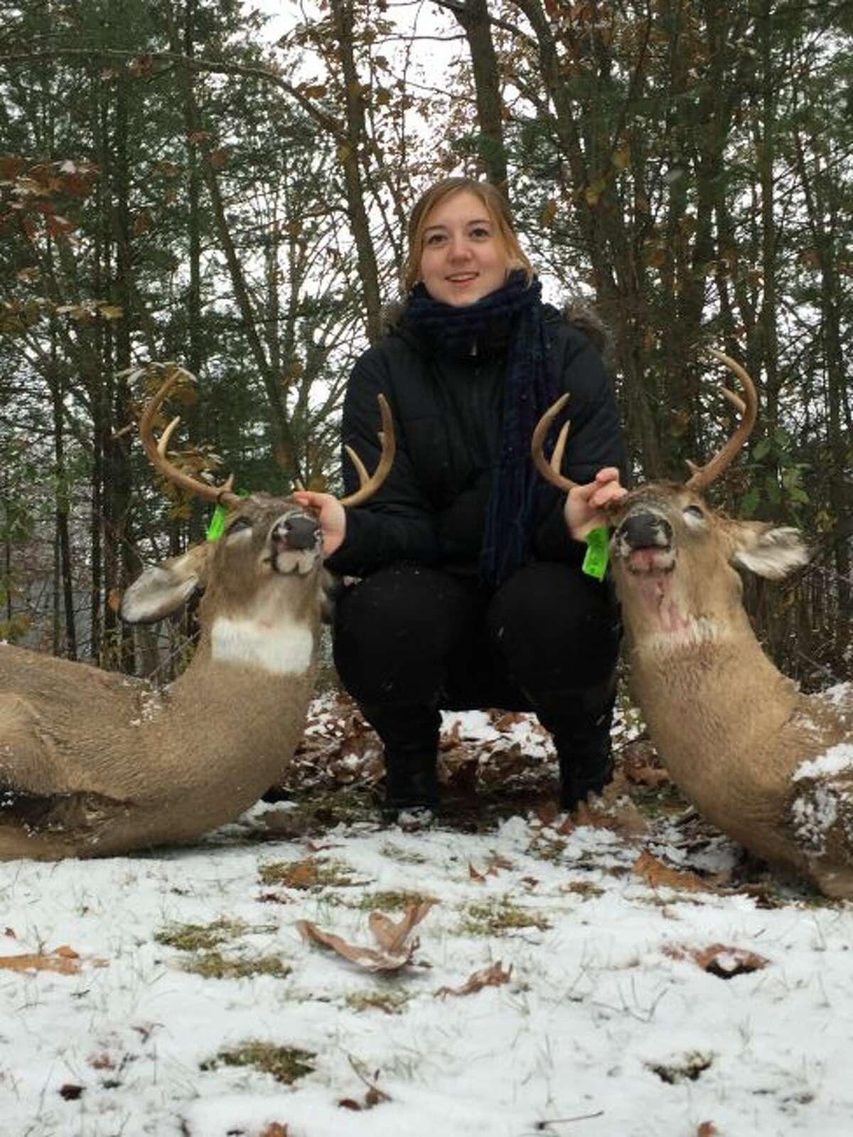 Emily Fabus shows her two bucks/