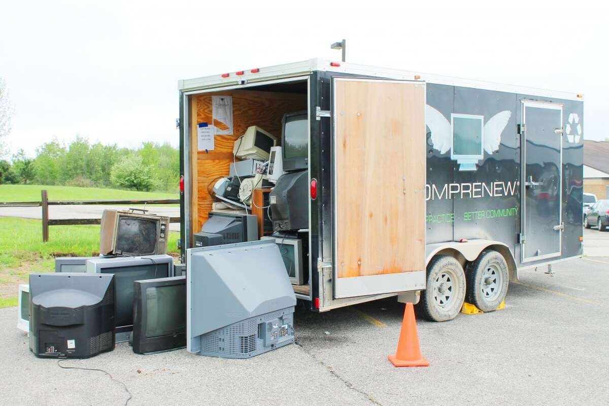 Proper disposal: Broken televisions and other electronics overflow from a Comprenew trailer sitting at Pine River High School. The school and community members participated in an electronic waste recycling drive and filled almost two large trailers. (Courtesy photo)