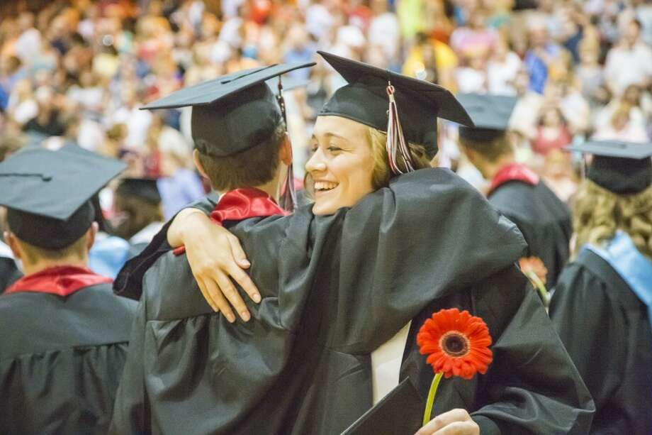 Friends, Amy McKee and Owen Rushford hug at the end of the graduation ceremony at Reed City High School. (Pioneer photos/Justin McKee)