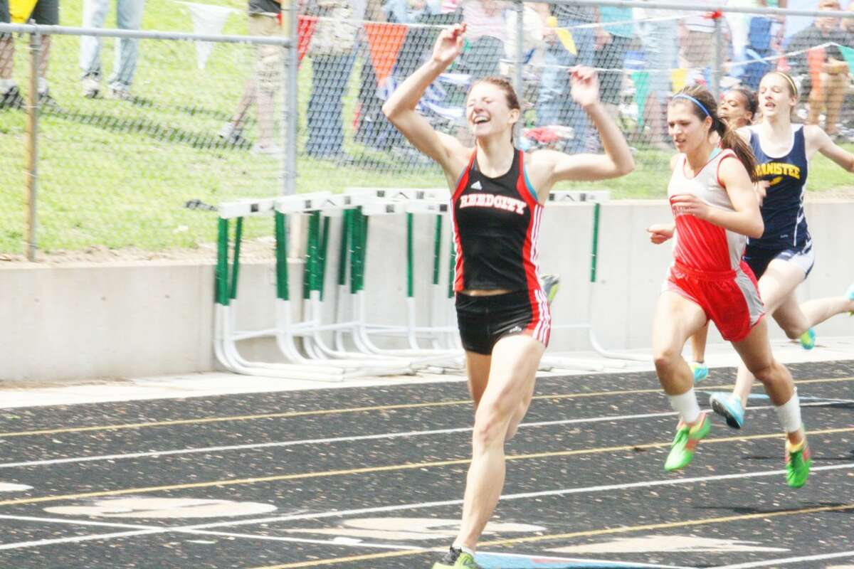 Sami Michell reacts after crossing the finish line of the 200-meter dash at the state finals for her last high school race.