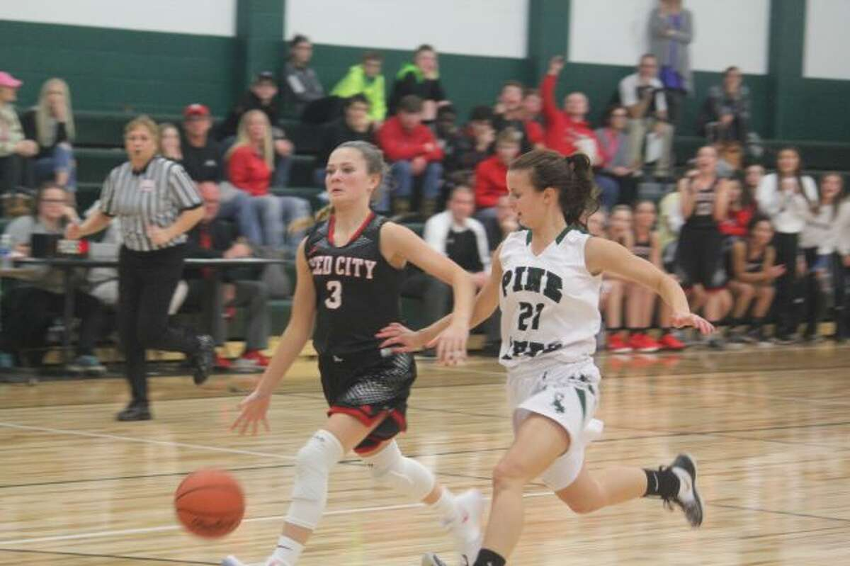 Kamryn Myers heads to the basket against Pine River.