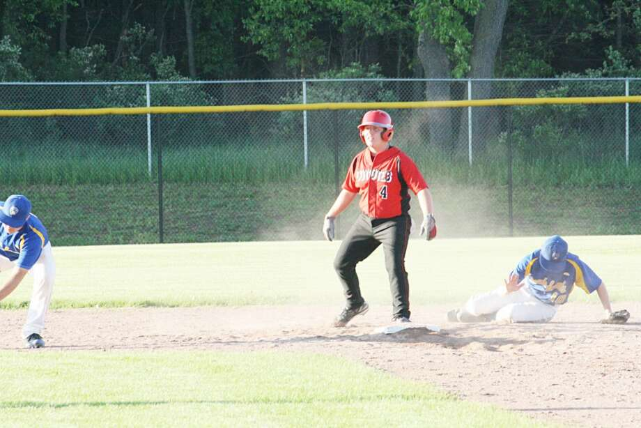 Reed City over Evart: Austin Hansen (4) of Reed City makes it safely to second base against Evart's infield. (Herald Review/ John Raffel)