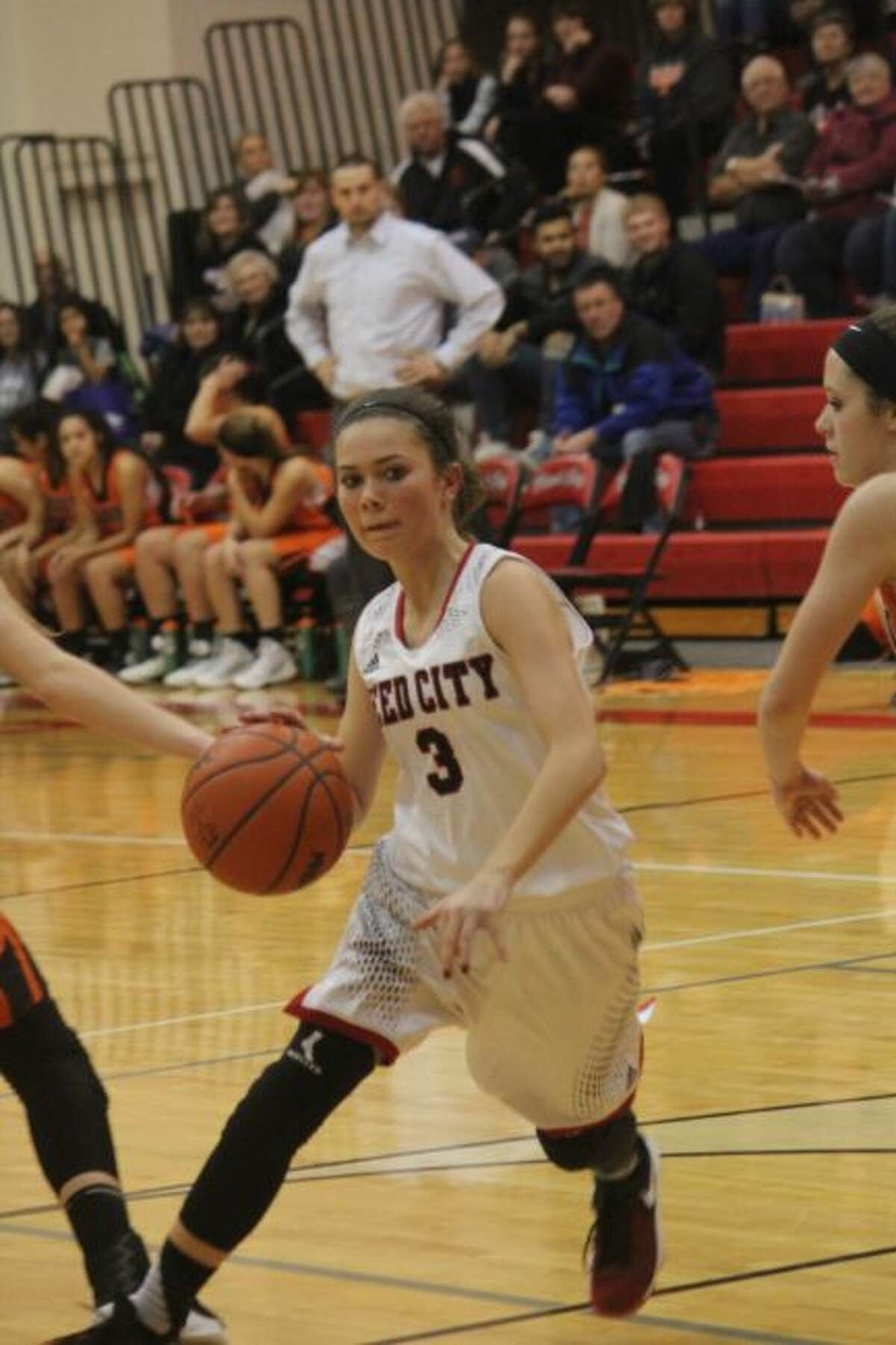 Kamryn Myers goes to the hoop for Reed City.
