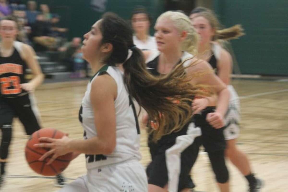 Anselma Barnett glides to the basket for Pine River.