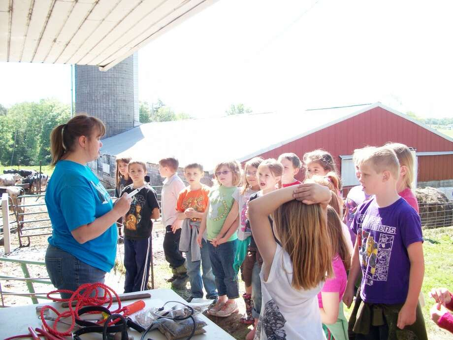 Hands-on experience: For some of the Reed City students, this was the first time they had ever been to a farm. The trip gave them the opportunity to learn about agriculture in a way the students could relate to.