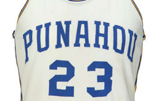 Barack Obama's high school basketball jersey was sold at auctions by Heritage Auctions.