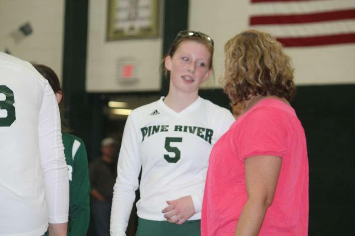 KayLee Goodman of Pine River confers with coach Jana Dennis.