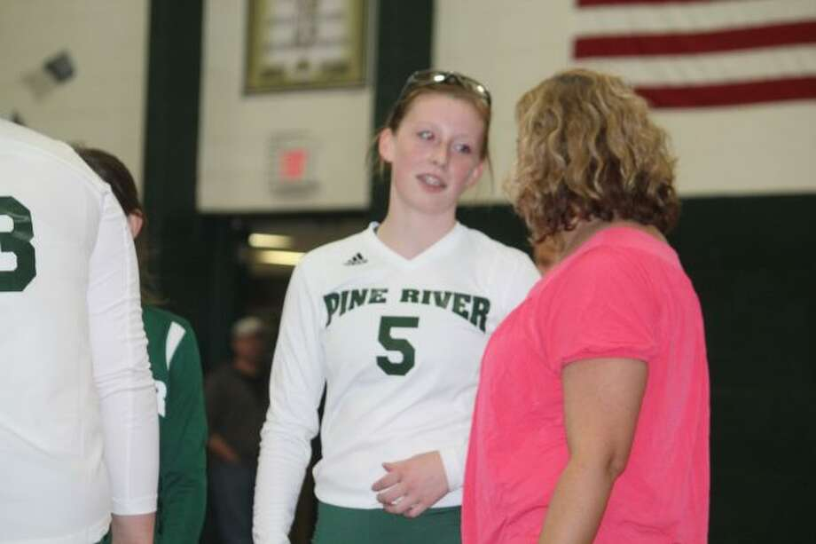 KayLee Goodman of Pine River confers with coach Jana Dennis.