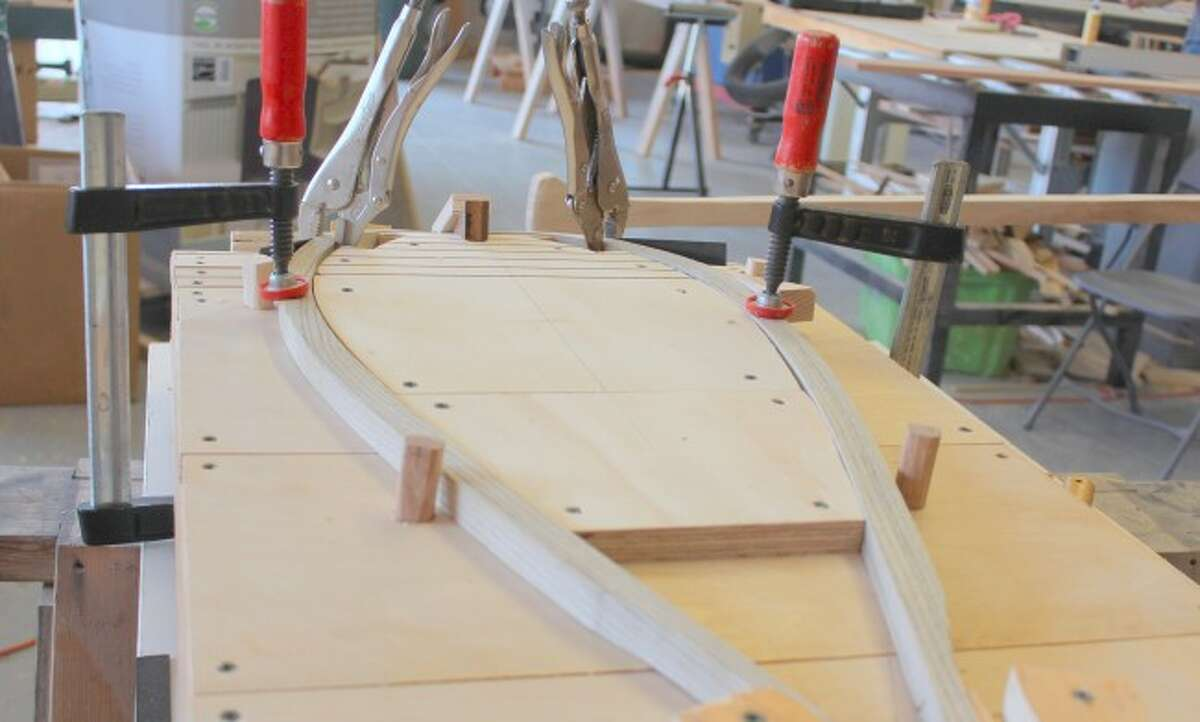 WOODWORKING: A pair of snow shoes is one of the commission projects currently being created in the shop. The men also are working on a bed frame and headboard, fishing nets and another canoe. Past individuals have created wood benches and refinished furniture.