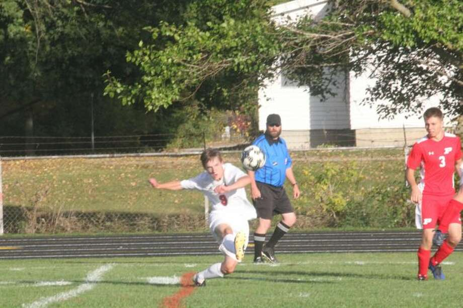 Reed City's soccer team is on the attack against Fremont.