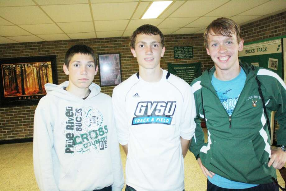 Track team: From left, Chris Terburgh, Ben Rigling and Trevor Holmes, plus Ethan Whitley (missing) were in the 3,200-meter relay for the Bucks this season. (Herald Review photo/John Raffel)