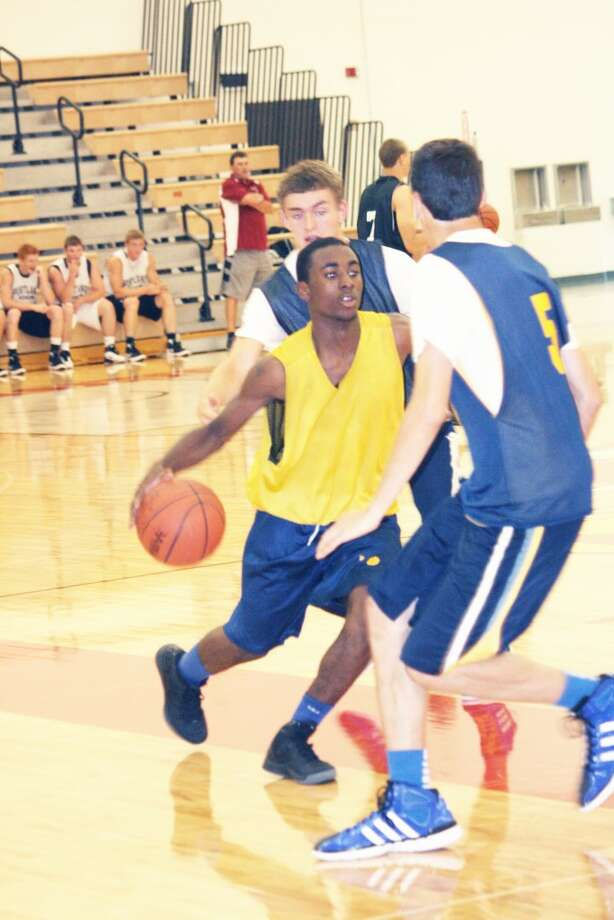 Keeping busy: Basketball teams will be busy during summer camps this month. (File photo)