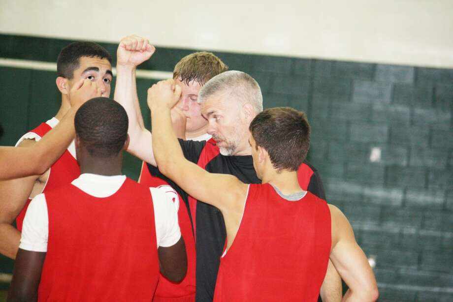 Summer basketball: Reed City boys basketball coach Dean McGuire gives encouragement to his team at the Pine River scrimmage on Saturday. (Herald Review/John Raffel)
