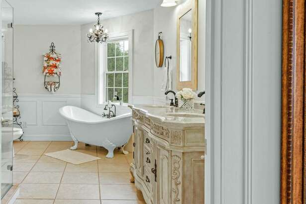 The updated master bath features new tiling and lighting fixtures, and radiant heated flooring.