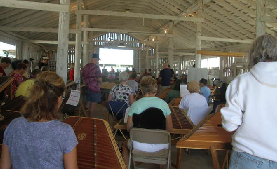 DULCIMER DAYS: (ABOVE) Musicians fill a barn at the Osceola County 4-H FFA fairgrounds to play dulcimers during a workshop at the 2012 Dulcimer Funfest. This year is the 41st annual festival and will be held from Thursday, July 18 to Sunday, July 21 at the fairgrounds. (File photo)