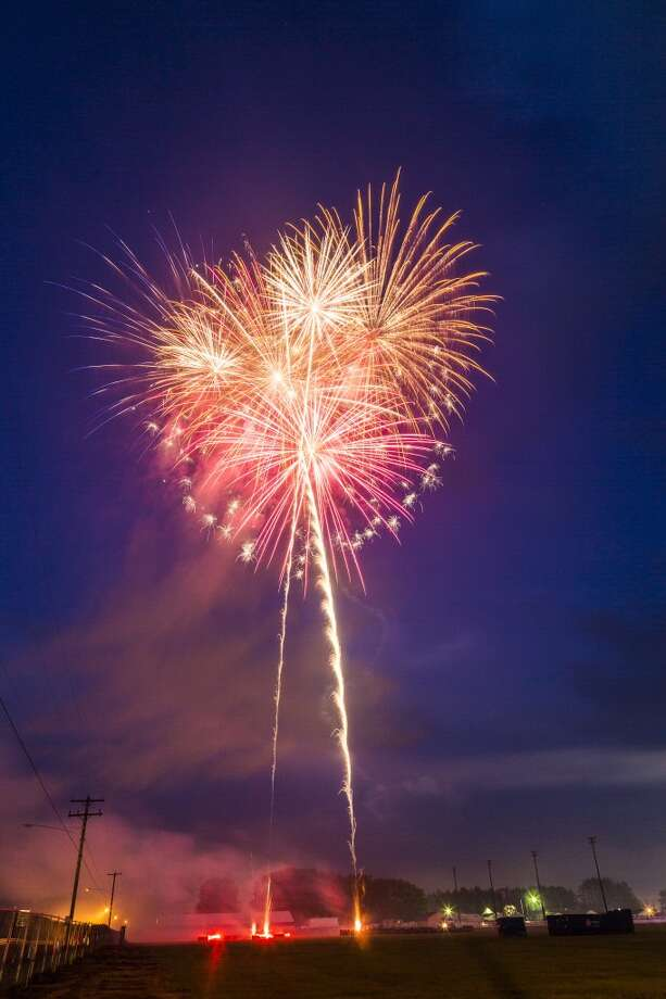 Fireworks light up the night sky during the show in Evart that took place on July 3. (Herald Review photo/Justin McKee)
