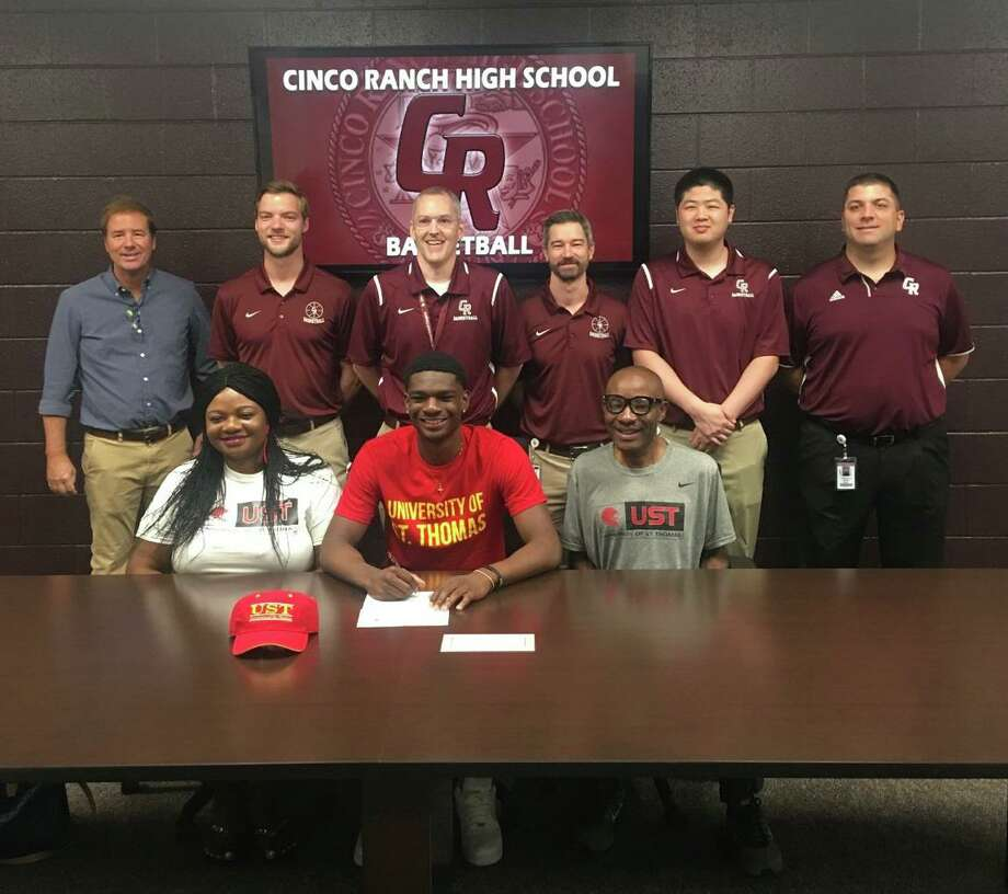 Cinco Ranch graduate Andrew Adebo signed a basketball scholarship with the University of St. Thomas. Adebo played two seasons with the Cougars, helping lead them back to the playoffs in 2019. Photo: Cinco Ranch High School / Cinco Ranch High School