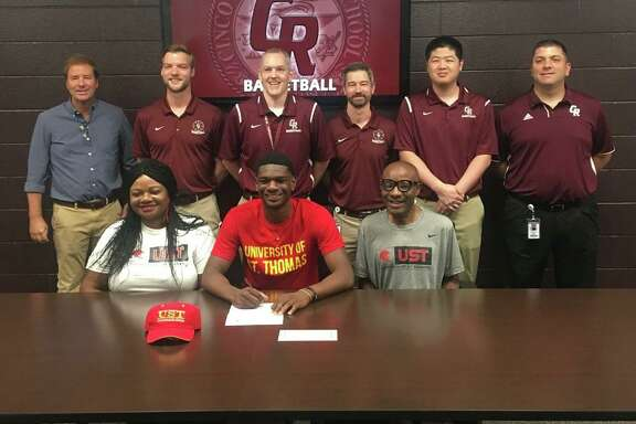 Cinco Ranch graduate Andrew Adebo signed a basketball scholarship with the University of St. Thomas. Adebo played two seasons with the Cougars, helping lead them back to the playoffs in 2019.