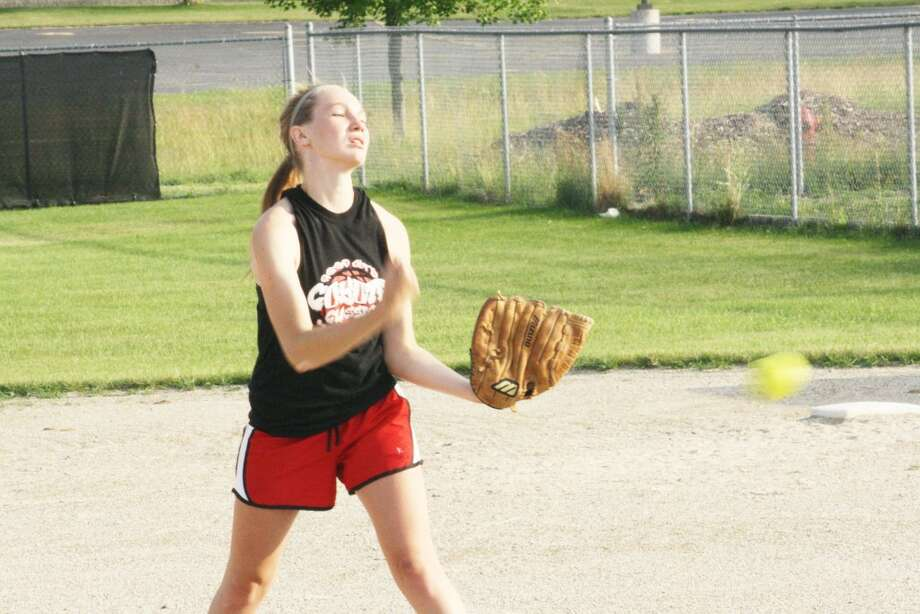 Summer practice: Skiler Brigham works on her pitching during a Reed City practice. (Herald Review/John Raffel)