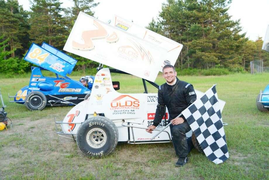 Race car winner: Ricky Droke celebrates a heat victory earlier this summer.(Courtesy photo)