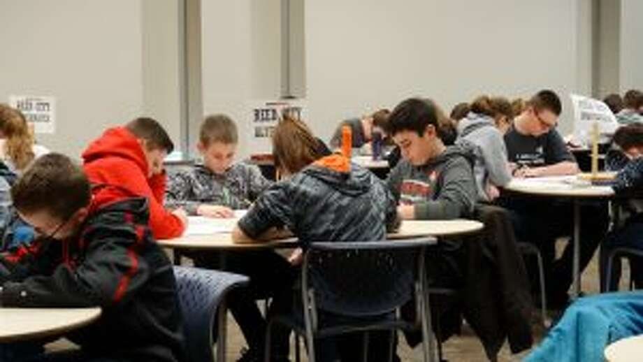 Sixth- through eighth-grade students begin the first MATHCOUNTS challenge of the day on Friday at Ferris State University. Of the eight schools present for the competition, six were from Osceola and Mecosta counties. (Herald Review photo/Meghan Gunther-Haas)