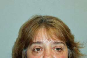 Theresa Ponger, 55, of Macintosh Road, Norwalk, was charged with interfering with an officer and reckless endangerment after her dogs allegedly attacked her neighbors earlier this month, in Norwalk, Conn.