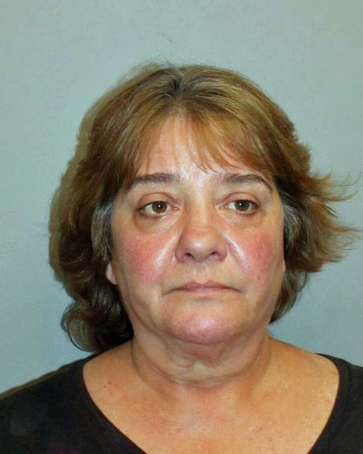 Theresa Ponger, 55, of Macintosh Road, Norwalk, was charged with interfering with an officer and reckless endangerment after her dogs allegedly attacked her neighbors earlier this month, in Norwalk, Conn. Photo: Contributed